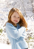 Jong meisje in sneeuw Stock Fotografie