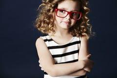 Jong meisje in sportkleding het glimlachen Stock Foto