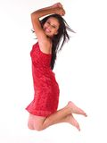 Jong meisje in springende houding stock afbeelding