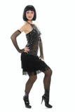 Jong meisje in weinig zwarte kleding. Stock Afbeeldingen