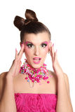 Jong meisje zoals een pop in roze kleding Stock Afbeelding