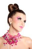 Jong meisje zoals een pop in roze kleding Royalty-vrije Stock Fotografie