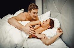Jong mooi paar in bed royalty-vrije stock foto's