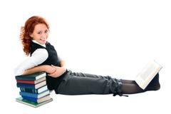 Jong mooi studentenmeisje met boeken stock foto's