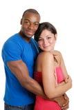 Jong paar dat elkaar gelukkig clutching Stock Afbeelding