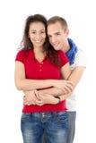 Jong paar die op wit omhelzen en wordt geïsoleerd Stock Foto
