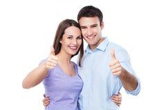 Jong paar met omhoog duimen Stock Foto's