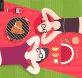 Jong paar op picknick, hoogste mening, vegetariër versus vleeseter Stock Foto