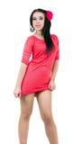 Jong sexy brunette in rode kleding Stock Fotografie