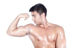 Het tonen van bicepsen stock foto's