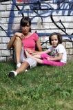 Jong sportief vrouw en kind Stock Foto