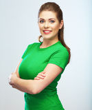 Jong vrouw geïsoleerd portret, gekleed groen stock foto's