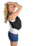 Jong vrouwen verfomfaaiend haar Stock Afbeeldingen