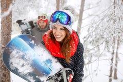 Jong wijfje snowboarder op de winter Royalty-vrije Stock Afbeeldingen