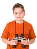 Jonge aantrekkelijke jongen met binoculair Stock Foto