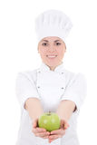 Jonge aantrekkelijke kokvrouw in eenvormig met groene appel   isolat Royalty-vrije Stock Afbeeldingen