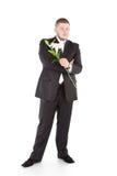 Jonge aantrekkelijke mens met bloemenorchideeën Royalty-vrije Stock Afbeelding