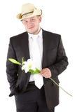 Jonge aantrekkelijke mens met bloemenorchideeën Stock Afbeeldingen