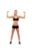 Jonge aantrekkelijke vrouw met gewichten Stock Foto's