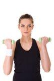 Jonge aantrekkelijke vrouwelijke oefening die gewichten gebruikt stock afbeelding