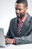 Jonge Afrikaanse Amerikaanse Zakenman Being Sneaky On stock foto