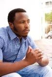 Jonge Afrikaanse mens in overpeinzing Royalty-vrije Stock Afbeelding