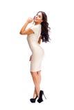 Jonge Arabische vrouw in beige sexy kleding royalty-vrije stock afbeelding