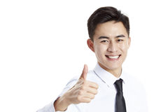 Jonge Aziatische bedrijfsmens die duim-op teken tonen stock foto