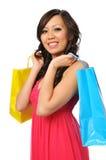 Jonge Aziatische vrouw met het winkelen zakken stock afbeelding