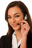 Jonge bedrijfsdievrouw met hoofdtelefoon over witte achtergrond wordt geïsoleerd Stock Foto's