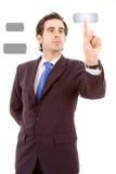 Jonge bedrijfsmens die een touchscreen knoop drukt Royalty-vrije Stock Afbeeldingen