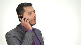 Jonge bedrijfsmens die mobiele telefoon met behulp van stock footage