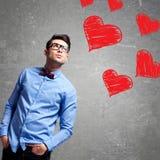 De mens denkt bij liefde stock foto's