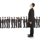 Jonge bedrijfsmens die op de lijn wachten Stock Foto's
