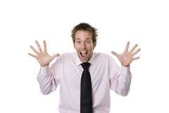 Jonge bedrijfsmens die verrast of doen schrikken kijkt Stock Foto's