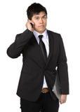Jonge bedrijfsmens met mobiele telefoon Royalty-vrije Stock Foto's