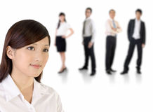 Jonge bedrijfsvrouw en haar team Stock Fotografie