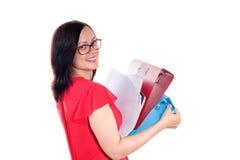 Jonge bedrijfsvrouw met stapel van ringsbindmiddel Stock Foto's