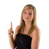Jonge blonde vrouw die één vinger houdt stock afbeelding