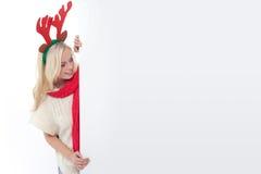 Jonge blonde vrouw met hoornen Stock Afbeelding