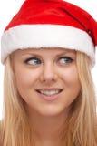 Jonge blonde vrouw in santahoed Royalty-vrije Stock Afbeeldingen