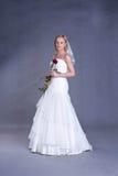 Jonge bruid in huwelijkskleding Royalty-vrije Stock Foto