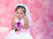 Jonge bruid met een grappige uitdrukking Stock Foto