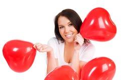 Jonge brunette met rode geïsoleerder harten Royalty-vrije Stock Afbeelding