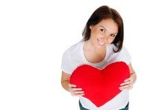 Jonge brunette met rood geïsoleerdr hart Stock Foto's