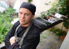 Jonge chef-kok royalty-vrije stock afbeeldingen