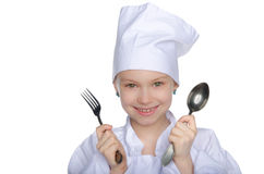 Jonge chef-kok met vork en lepel Stock Afbeelding