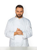 Jonge chef-kok op witte achtergrond Stock Foto