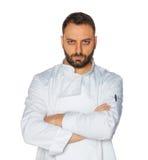 Jonge chef-kok op witte achtergrond Royalty-vrije Stock Foto