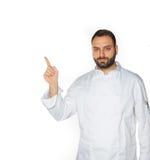 Jonge chef-kok op witte achtergrond Royalty-vrije Stock Afbeelding